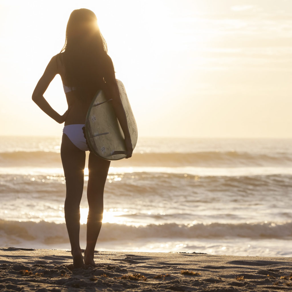 Surfer girl with Surfboard